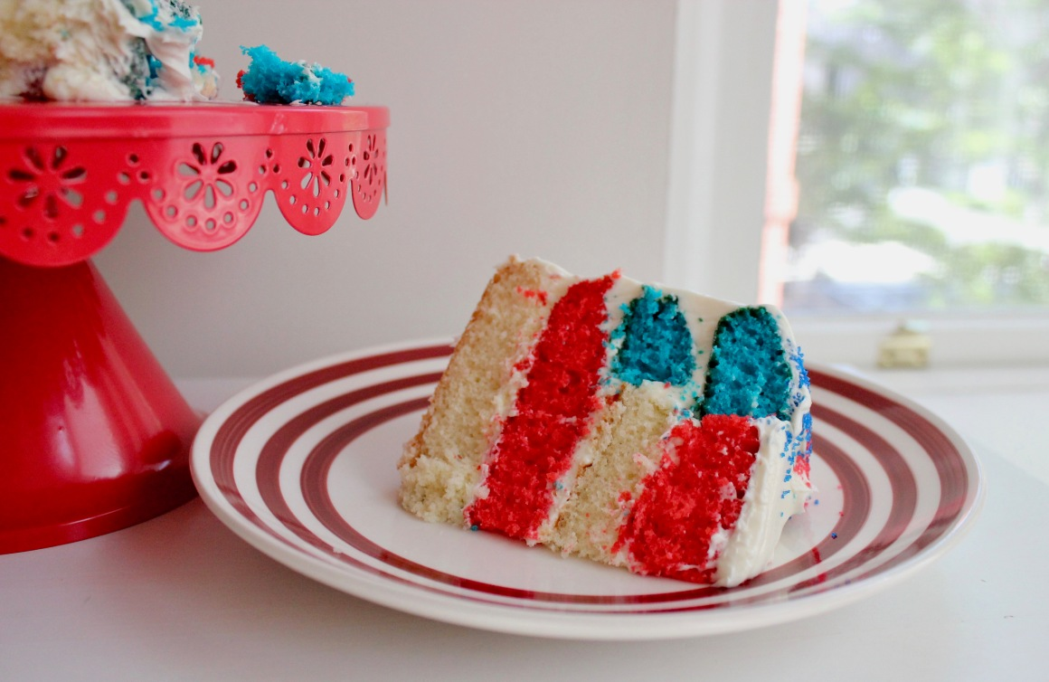 Flag cake next to a pile of cake on a cake stand.jpg
