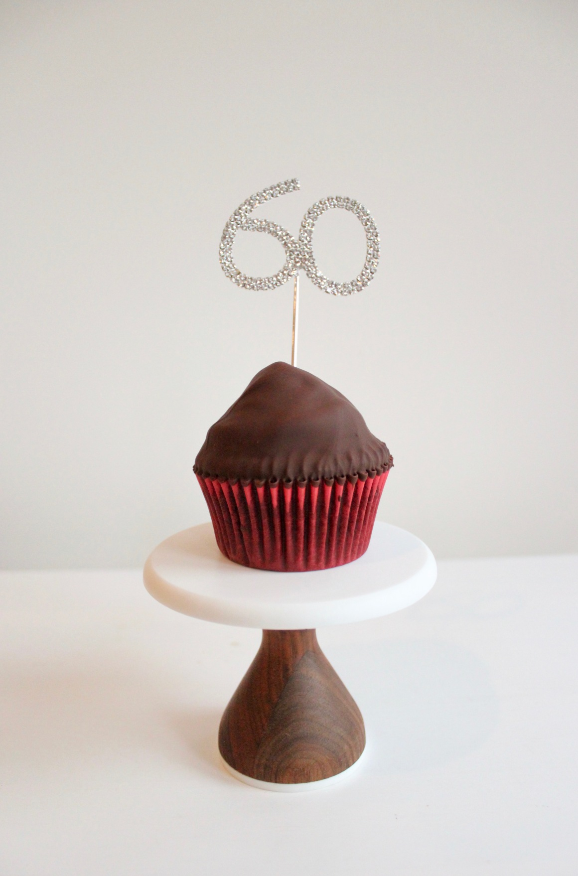 Sixtieth cake topper on a cupcake