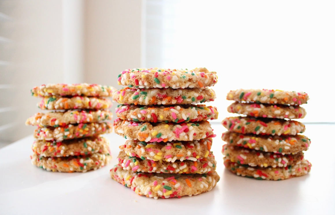 Three stacks of vanilla rainbow sprinkle cookies